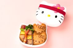Hello kitty lunch box with 2 pieces of Kitty inari-sushi