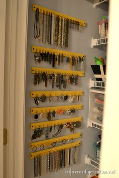Organizing jewelry with paint sticks. Just add push pins. I put up cork board squares and put stick pens in it and hung my earrings from it. I just stuck the stick pens in the sheetrock walls in my bathroom for my necklaces. Looks great
