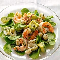 Seafood Salad with Creamy Tarragon Dressing~~~Serve this seafood mix on a bed of watercress or butter lettuce, or as a sandwich in toasted brioche buns or on crusty bread.