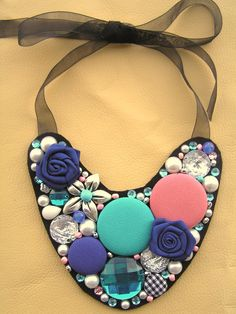 Exclusive fabric covered buttons necklace with some sparkling and beads... Made by Falar com os meus botões! Visit us on facebook!