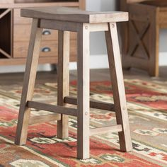 defined by a saddlestyle seat and this understated stool lends a touch of simple to your living room or kitchen ensemble