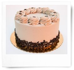 Chocolate cake layers are filled with ganache and rich coffee whipped cream; the cake is iced in mocha buttercream and finished with chocolate shavings, rosettes and chocolate chips.