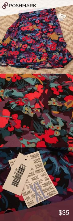 Gorgeous floral Azure Lularoe NWT Brand new! This is so beautiful in person! Base color is black! LuLaRoe Skirts Midi
