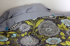 Sew button holes on flat sheet and buttons on duvet to keep duvet clean.