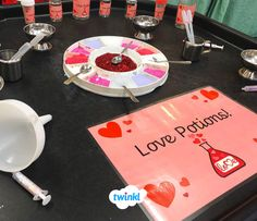 Love potion making station - perfect for Valentine's Day. Can your children make a love potion to take home to their loved ones? This is a great fine motor