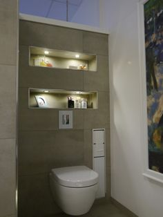 Idee voor de WC, let ook op de verlichting