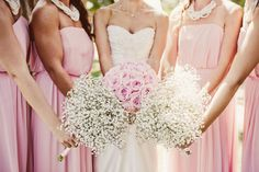 Babies breath bridesmaids bouquets and pink o'hara garden roses for the bride. Designed by Blooms & Posies www.bloomsandposies.com