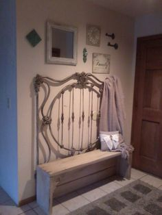 I love this entry way. DIY headboard bench. Cream decorations. Antique beauty. LOVE IT!!
