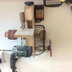 Multi Sander by Jambutty john -- Homemade multi sander constructed from lumber, grinding wheels, a power switch, and an electric drill. http://www.homemadetools.net/homemade-multi-sander