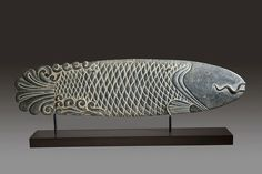 Chinese, 17th century (late Ming) stone carving of a stylized fish. From a temple in Shanxi Provence.