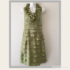 "London Times dress with layered ruffles. Soft green dress with v-neck adorned by feminine ruffles. Slightly gathered bodice for a flattering fit and these cascading ruffles will make you feel like you're floating into a room. Dress is rayon/poly blend, fully lined and zips in the back. Perfect to wear to a wedding or graduation party. Like new condition, worn only one time. Bust measures appx 17"" from armpit to armpit bottom if bodice is 15"" acrosslength is 39"" long from shoulder to hemline…"