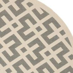 @Overstock - This outdoor rug has a brown background and displays stunning panel color of natural. This power-loomed rug is resistant to mold, mildew, sun, water and other elements.http://www.overstock.com/Home-Garden/Poolside-Grey-Bone-Indoor-Outdoor-Rug-67-Round/6551510/product.html?CID=214117 $109.99