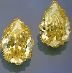 Formerly the Property of the Duchess of Windsor - A pair of pear-shaped, fancy yellow diamonds, weighing 40.81 and 52.13 carats and incorporated into lapel pins were sold by Harry Winston to the Duke in 1948.