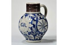 Westerwald Stoneware GR Jug, Germany, c. 1730, the gray body decorated with blue stylized incis