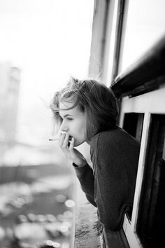 Something ironic and beautiful about a beautiful young girl smoking a cigarette