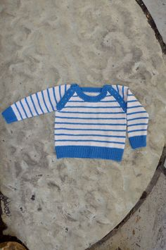Free Pattern Friday - Skipper Sweater knit in Universal Yarn Bella Cash. Machine washable, with button bands at the armholes for maximum practicality!