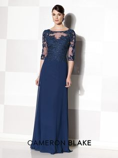 Three-quarter sleeve chiffon and lace A-line gown, illusion bateau neckline, sweetheart bodice, covered buttons down illusion back, sweep train.Sizes: 4 - 20, 16W - 26W