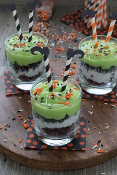 """Celebrate Halloween with a """"melted witch"""" pudding parfait. Mix up some green pudding and add in brownie pieces, whipped cream, and oreos. Top the parfait with easy to make witch's legs! Comida De Halloween Ideas, Recetas Halloween, Fete Halloween, Halloween Baking, Halloween Punch, Halloween Goodies, Halloween Desserts, Halloween Food For Party, Halloween Cupcakes"""