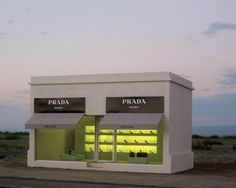 IN THE MIDDLE OF THE WEST TEXAS DESERT AND NEAR MARFA, TEXAS, DESIGNER PRADA brings a designer's touch to this quaint, spooky area where we Texans see strange lights, historically known as The Marfa Lights phenomenon! The outside world did not forget this proper ground~