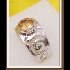 Citrine, Brazilian Ring Brazilian Citrine in .925 Sterling Silver Nickel Free (Size 7) 0.85 CT. Bezel set gem in a very nicely detailed setting. Jewelry