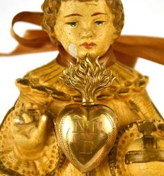 Small Antique 19th Century Gilded Brass Sacred Heart Ex Voto Reliquary from lachapelleprivee on Ruby Lane