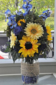 Mason Jar Centerpieces sunflowers | Nicole & Ryan's centerpiece made from a mason jar filled with cobalt ...