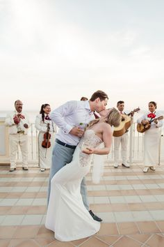Whether you're getting married in Cancun, Puerto Vallarta or Los Cabos, hiring a local Mariachi Band is a great way to incorporate Mexican culture into your destination wedding!  Photo credit: By Julieta Photography
