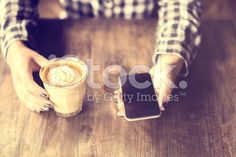 Hipster girl holding a coffee and cell phone royalty-free stock photo