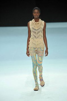 I don't know if this Issey Miyake work is actually crochet (doesn't look like it to me) but it's pretty!