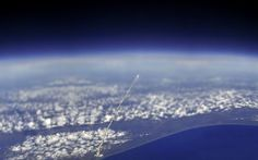 The view of a space shuttle launch from the ISS