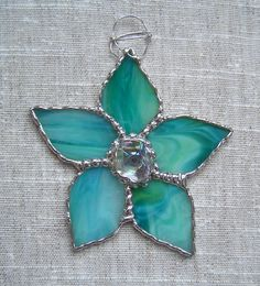 Items similar to Stained Glass Flowers Suncatcher Ornament on Etsy Stained Glass Ornaments, Stained Glass Christmas, Stained Glass Suncatchers, Stained Glass Flowers, Faux Stained Glass, Stained Glass Designs, Stained Glass Projects, Stained Glass Patterns, Tiffany Glass