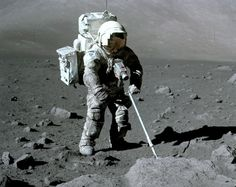 Apollo 17 lunar module pilot Harrison Schmitt uses an adjustable sampling scoop to retrieve lunar samples during the second Apollo 17 moon walk. His spacesuit is covered with a layer of the lunar dust. (Image Credit: NASA/Eugene Cernan)