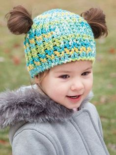 ANNIE'S SIGNATURE DESIGN: Messy Bun & Pigtail Crochet Hat pattern from Annie's Craft Store. Order here: https://www.anniescatalog.com/detail.html?prod_id=135335&cat_id=468