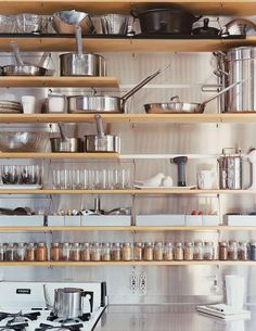Kitchen space to consider--shelves like these above a counterspace in the corner of my studio. Makeshift kitchen space with more storage than just the bookcase and the storage chest currently provide.
