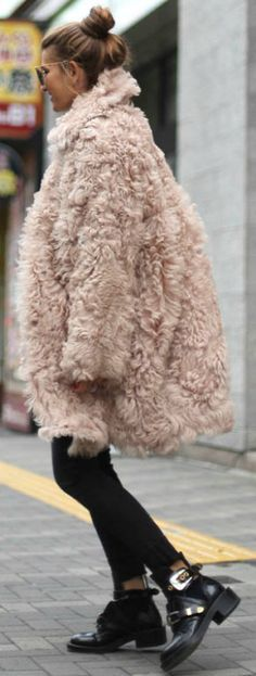 Silvia Garcia + eye catching faux fur coaT + pair of chunky buckled boots + simple black jeans Coat: Essentiel, Jeans: Asos, Sweater: H&M, Boots: Balenciaga, Bag: Chanel. Cute Winter Outfits.