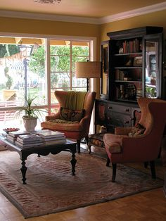(BrandonRugs.com) The hand-woven Aubusson rug defines the living room area in an open floor-plan.