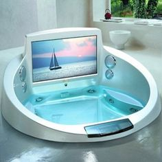 I want this verry much. just watching TV in my juccuzi. That is very awesome! who would not want this ?!