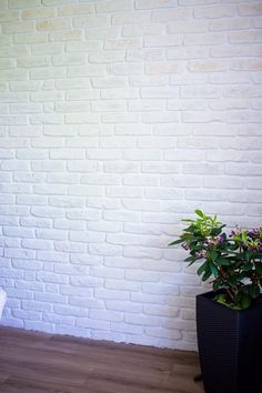 Urban Feature Wall using Rustic White brick slips and bright white mortar Brick Paneling, Brick Interior Wall, White Brick, Tiles Uk, Brick Living Room, Rustic White, Brick Painted White, Stone Cladding, Painted Brick