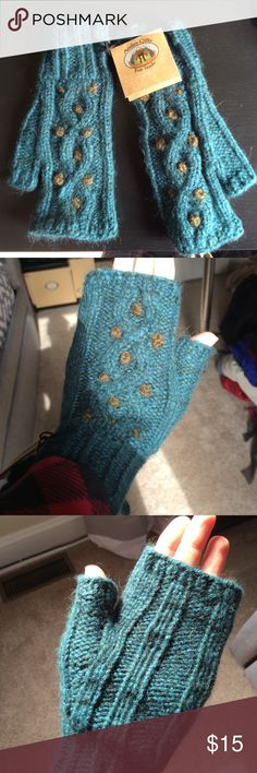 Wool fingerless gloves Beautiful handmade fair trade wool, teal fingerless gloves. New with tags. Super cute, warm, and perfect for texting while keeping your hands warm! Andes Gifts Fair Trade Accessories Gloves & Mittens