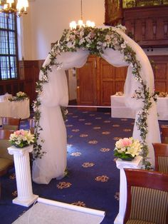 What do you think of the general look of this one that combines material and vines and flowers? I would probably suggest not making the fabric look too saggy and the distribution of the flowers would look a little let stuffy and traditional, but what do you think of the general look? (keep in mind-- you don't actually stand in front of the arch, just right in front of it. it's your decorative background, not your roof.)