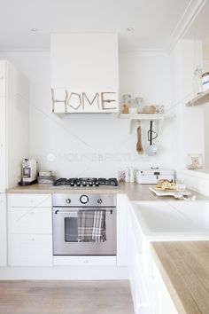 White cupboards with pale butcher block counters and deep sink and hanging utensils under shelves Old Farmhouse Kitchen, Kitchen Dinning, New Kitchen, Kitchen Decor, Kitchen White, White Cupboards, Piece A Vivre, Shabby, Dining Room Design
