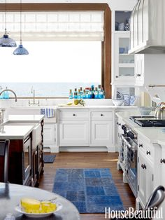 Two farmhouse sinks, from Rohl on the island and Kallista by the window, have an old-fashioned look.