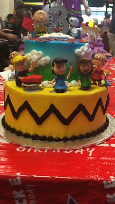 Charlie Brown Birthday Cake This cake was made by Walmart and the characters were bought from Target and placed on the cake. The chevron candles were also purchased from Walmart.