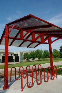 The newly constructed bike shelters on the UWGB campus serve as a visual reminder to the campus community to bike instead of drive to improve the environment, as well as personal health and wellness. This shelter can be found between MAC Hall, ES, and the Cofrin Library.