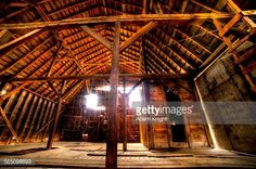 Stock Photo : Low angle view of interior wooden frame of large barn loft