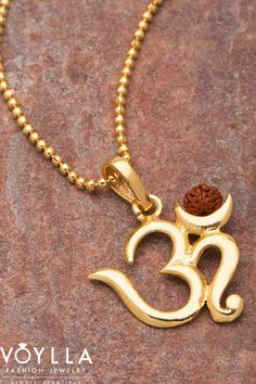 Rudraksha Studded Pendant With OM The Accessory: A classy, religious with pendant from our collec Mens Gold Bracelets, Mens Gold Jewelry, Gold Jewelry Simple, Gold Jewellery Design, Women's Bracelets, Om Pendant, Gold Pendent, Pendant Jewelry, Gold Chain With Pendant