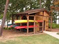 shed with canoe & kayak storage. Kayak Storage Rack, Kayak Rack, Boat Storage, Storage Ideas, Utility Boat, Wooden Kayak, Boat Shed, Lakeside Living, Outdoor Living
