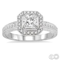 Princess cut diamond engagement ring with halo and channel set band.