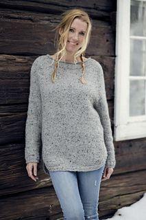 Basic but feminine tweed wool sweater with a deeper raglan yoke and a rounded split hem.