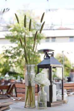 simple flowers and candle lantern centerpiece